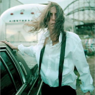 """Patti Smith at Coney Island in 1996, from the documentary """"Patti Smith, Dream of Life."""" Credit Steven Sebring"""
