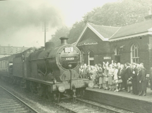 Saltaire workers wave as they catch the train for an outing to the seaside.