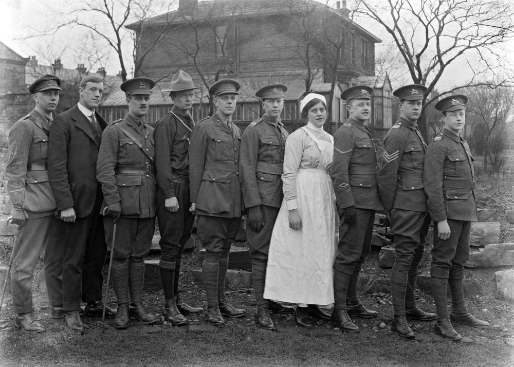 Christopher with his brothers and sister in military uniform