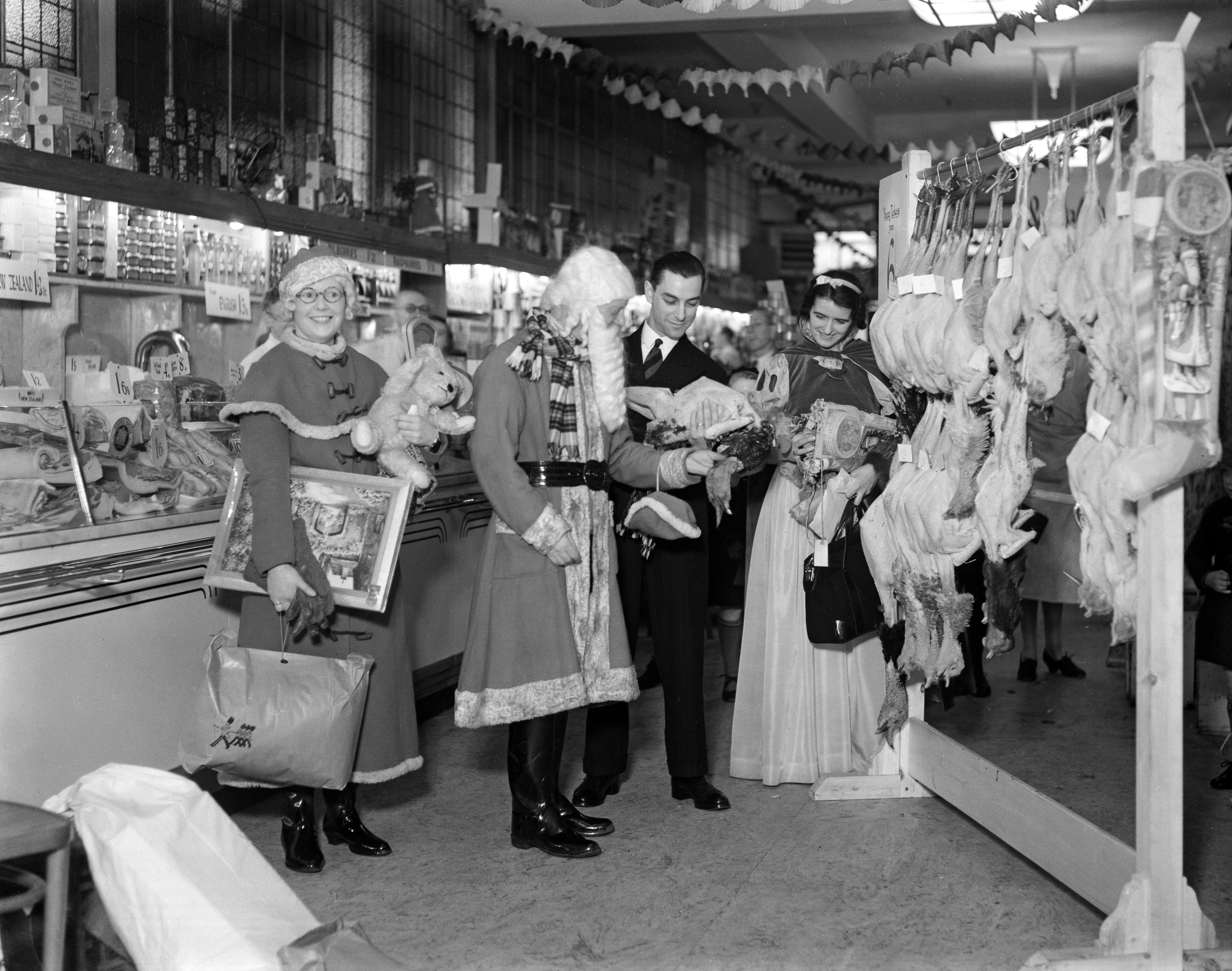 Father Christmas in the Food Hall at Busbys' department store, Manningham Lane, Bradford.